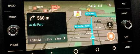 Have you tried Waze on Android Auto?